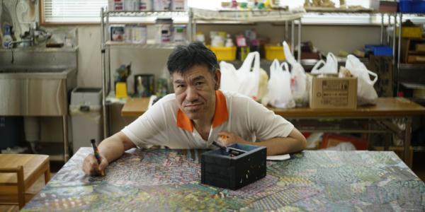 A photograph of NISHIKAWA Yasuhiro's face