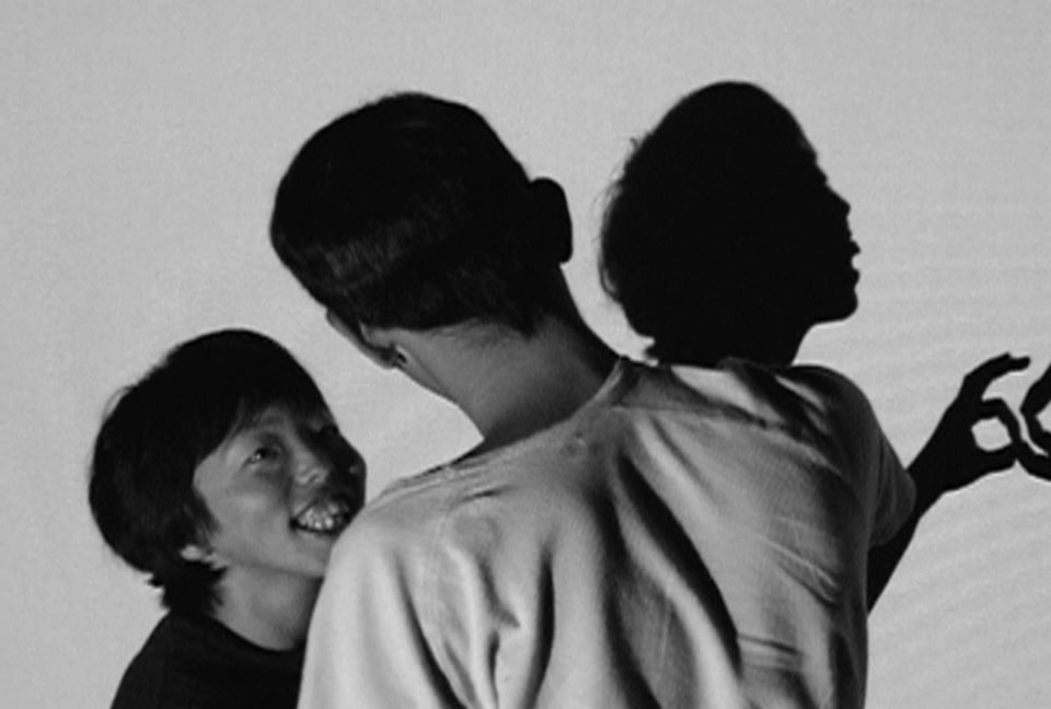 """(About the photo)Ito and Sakuma participated together in 'Able Art Link 2007', which was a project where an artist and a person with disabilities form a pair to build a new relationship and artwork. Their shadows of dancing were projected on the screen to breakdown stereotypes between people with and without disabilities. ('Able Art Link Project' in collaboration with video artist Chie Yamada / """"Aible Art Kinki 2007 Hito – Art – Machi Kyoto"""", 2007, organized by Kinki Rodou Kinko)"""