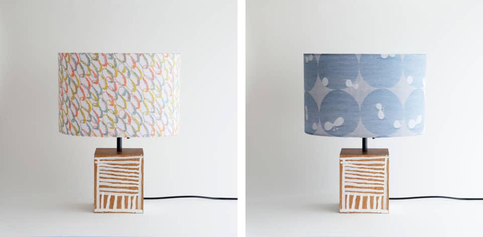(写真について)POOL×しょうぶ学園「マチマチの灯り」。家具の端材を用いた土台に、園生が一つずつ図柄を描いたランプ。シェード部分に使用したのは、ミナ ペルホネンと無印良品の生地。 Photo:minä perhonen